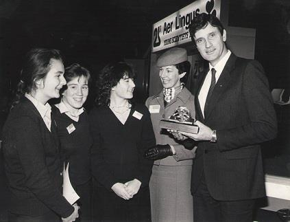"""Young Scientists Exhibition 1985. Dr C O'Rourke presenting the Institute of Biology of Ireland Award for Best Group project in Biology to (left to right) Niamh Mulvany, Sinead Doyle and breda Maguire, Rosary College, Raheny for their project on """"The Bull Island - Flora versus Soil Type""""."""